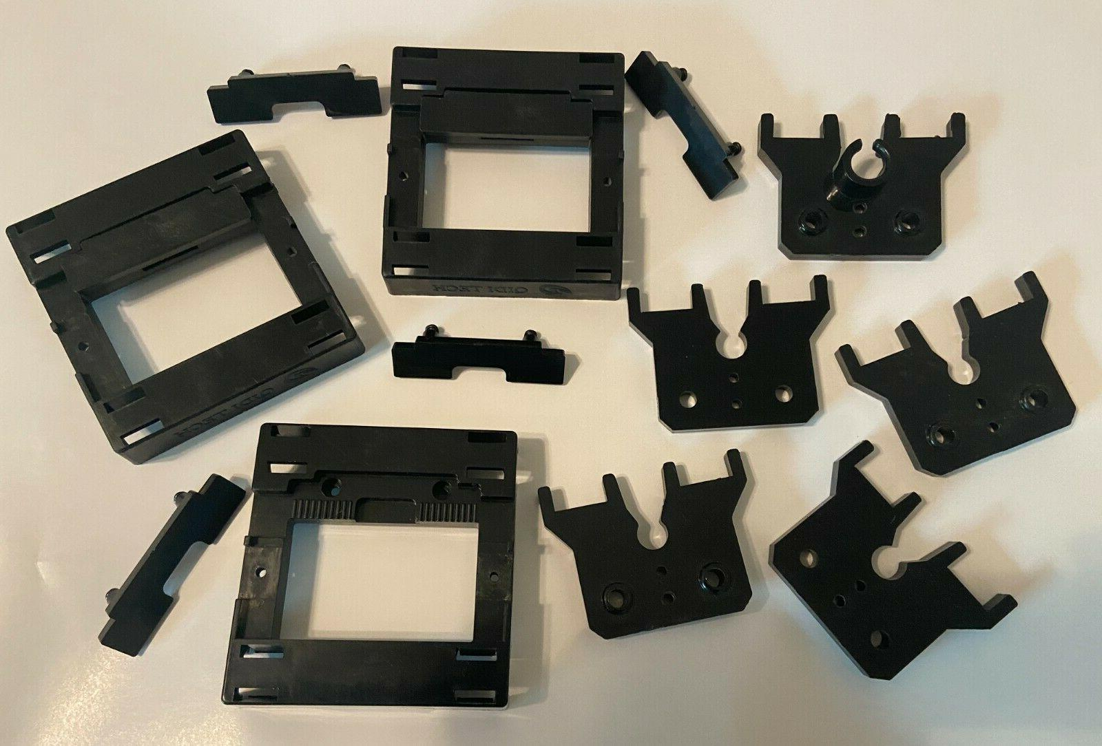an assortment of plastic parts for qidi